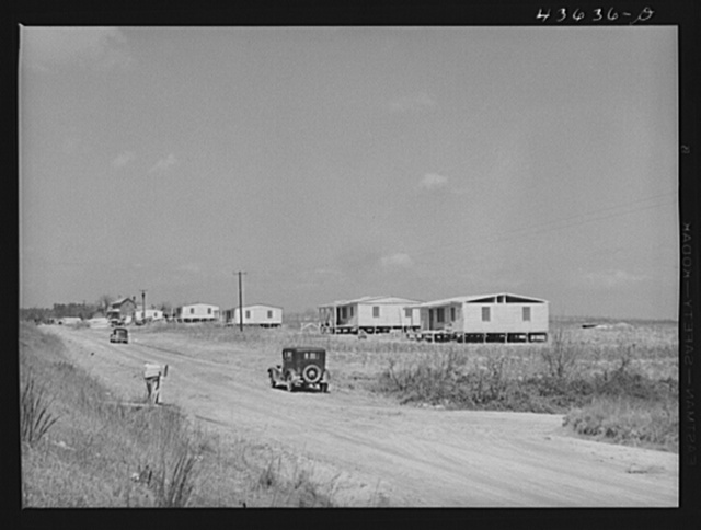 Prefabricated houses being constructed near Pacolet, South Carolina, by the FSA (Farm Security Administration) for farmers moved out of the Camp Croft area region