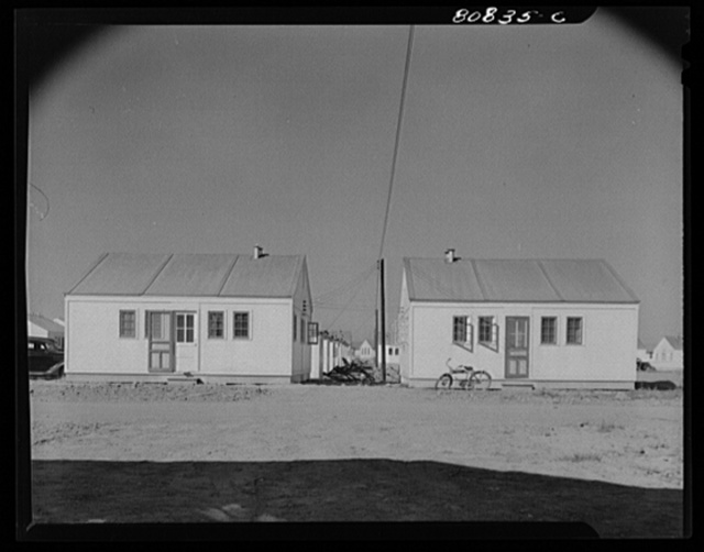 Prefabricated houses designed to accommodate two families. FSA (Farm Security Administration) defense housing project. Hartford, Connecticut
