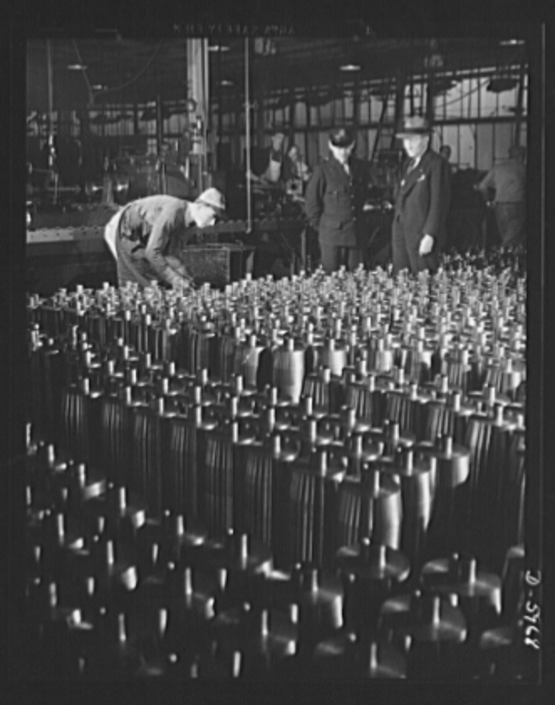 Production. 155mm shells. Careful inspection precedes the operations which form the noses of 155mm shells in a converted auto plant. Willy's, Toledo, Ohio