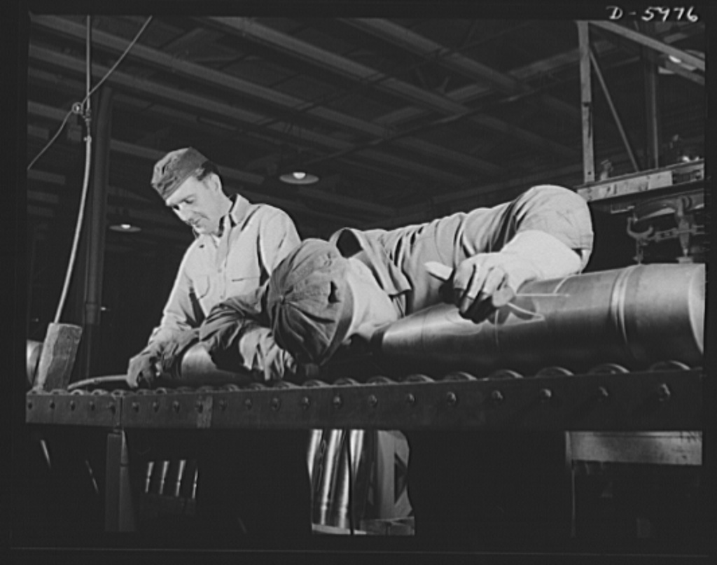 Production. 155mm shells. Inspecting 155mm shells, on which all machining operations have been completed, before painting in a converted auto plant. Willy's, Toledo, Ohio