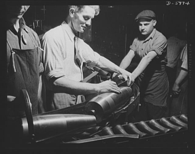 Production. 155mm shells. Inspection after the finish turning of straight and profile diameters of 155mm shells in a converted auto plant. Willy's, Toledo, Ohio