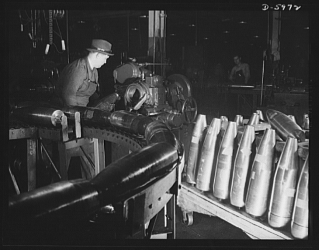 Production. 155mm shells. Threading the nose ends of 155mm shells in a Less-Bradner thread mill at a converted auto plant. Willy's, Toledo, Ohio
