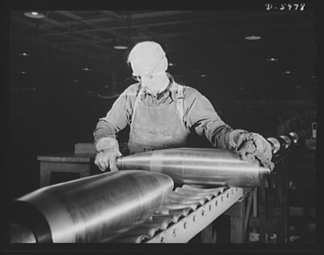 Production. 155mm shells. Threads cut in the noses of 155mm shells by Less-Bradner thread mills are inspected in a converted auto plant. Willy's, Toledo, Ohio
