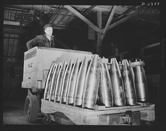 Production. 155mm shells. Transferring 155mm shells for finishing work in a converted auto plant. All machining operations on these shells have been completed and they are now on their way to the painting department. Willy's, Toledo, Ohio