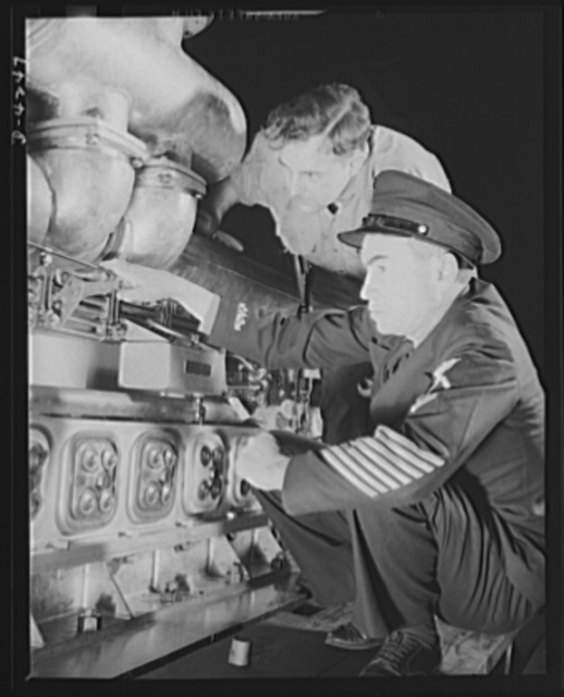 """Production. Diesel engines. A diesel engine produced for the Navy at a Midwest manufacturing plant, is inspected by a """"five strip"""" chief petty officer"""