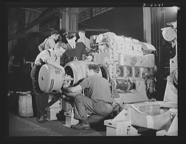 Production. Diesel engines. An electrical generator is coupled to a diesel engine being made for the Navy at a Midwest manufacturing plant