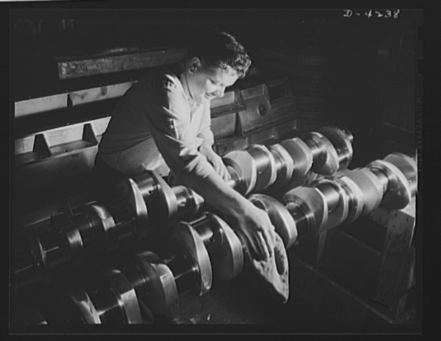 Production. Diesel engines. Crankshafts are prepared for assembly into diesel engines being made for the Navy at a Midwest manufacturing plant