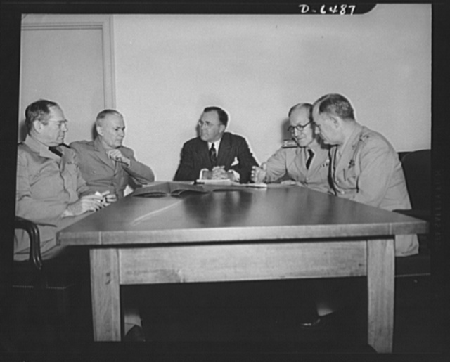 Production Executive Committee. First meeting of Production Executive Committee of the War Production Board (WPB). Charles E. Wilson, President of General Electric Company and WPB Vice Chairman of the Committee. Committee members, left to right: Rear Admiral Howard L. Vickery, Vice Chairman, U.S. Maritime Commission; Lieutenant General Brehon B. Somervell, Commanding General, Services of Supply, U.S. Army; Mr. Wilson; Vice Admiral Samuel M. Robinson, Director of Material and Procurement, U.S. Navy; and Major General Oliver P. Echols, Commanding General, Material Command Headquarters, Army, Air Force