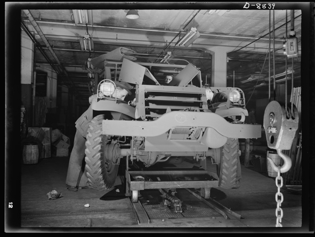 Production. Halftrac armoured cars. Another halftrac scout car leaves a body assembly line in an Eastern plant producing locks and safes. Diebold Safe and Lock Company, Canton, Ohio