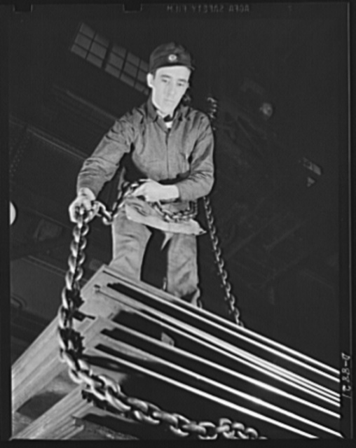 Production. Halftrac armoured cars. Attaching a chain sling to a lift of steel plates for the production of halftrac scout cars in a converted Eastern lock and safe plant. Diebold Safe and Lock Company, Canton, Ohio