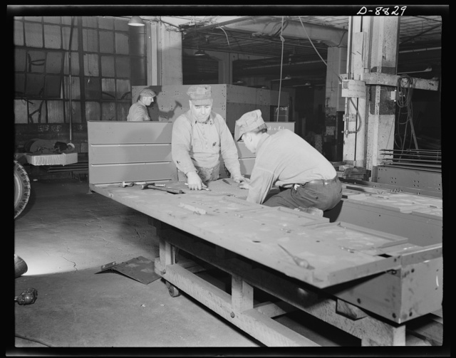 Production. Halftrac armoured cars. Attaching body parts to a halftrac scout car in the converted Eastern plant of a lock and safe manufacturer. Diebold Safe and Lock Company, Canton, Ohio