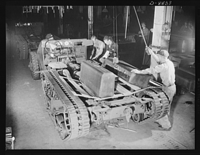 Production. Halftrac armoured cars. Preparing to install non-leaking gasoline tanks on the chassis of a halftrac scout car. The Eastern plant in which the body is made and installed formerly produced locks and safes. Diebold Safe and Lock Company, Canton, Ohio