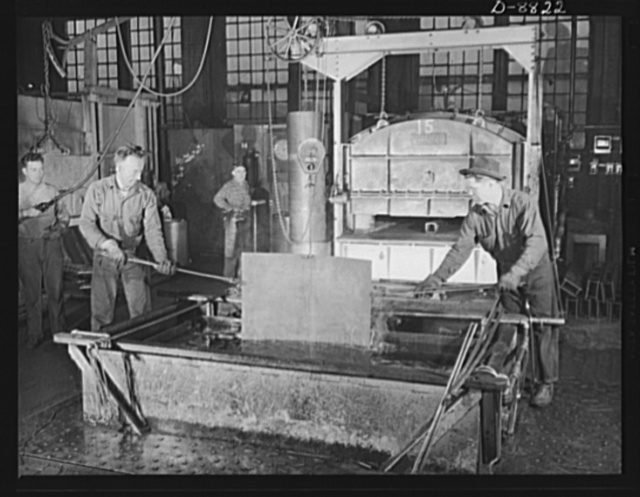 Production. Halftrac armoured cars. Steel sheets from which body parts for halftrac cars will be made are case-hardened in a large Eastern plant converted from the manufacture of locks and safes. Diebold Safe and Lock Company, Canton, Ohio