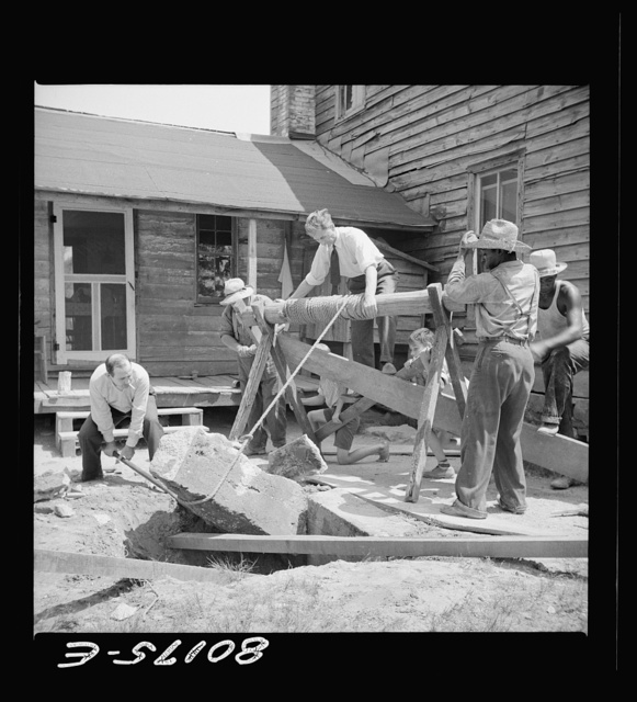 Removing a large block of old concrete. Safe well demonstration near La Plata, Maryland. Charles County
