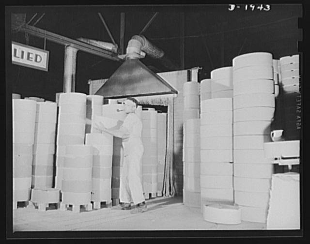 Removing saggers and ware from exit end of tunnel kiln. Shenango Pottery Works, Newcastle, Pennsylvania