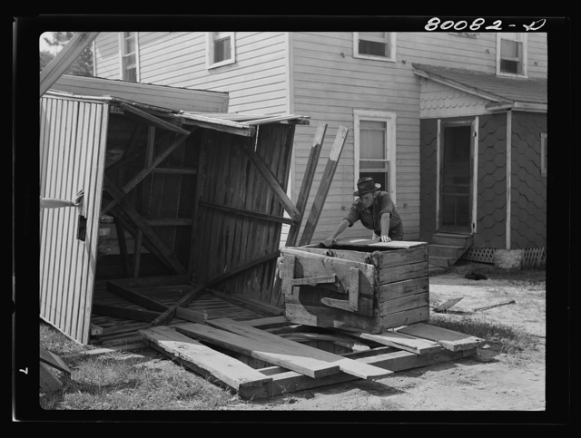 Removing the house and well cover. Safe well demonstration near La Plata, Maryland. Charles County
