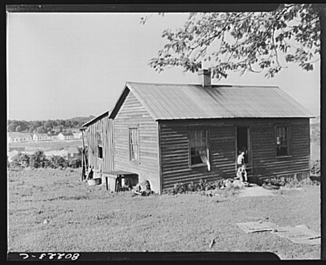 Rented house which will be torn down to make way for homes for defense workers of the expanding FSA (Farm Security Administration) housing project of Radford, Virginia. From nine days to as little as four days notice has been given to tenants and landholders before construction gangs tore down their homes