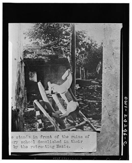 Rocking horse left in the ruins of a nursery school wrecked by the Nazis during their invasion of the USSR (Union of Soviet Socialist Republics)