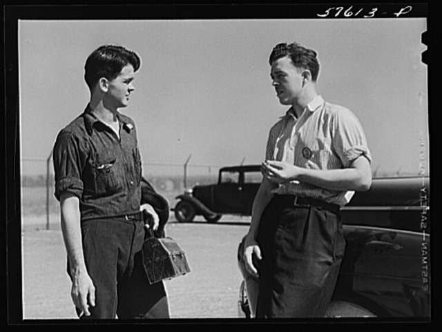 Rolfe Chickering, farmboy from Saint Johnsbury, Vermont, now working at Pratt and Whitney United Aircraft, East Hartford, Connecticut. He is talking to his friend with whom he commutes to Suffield, Connecticut (see 57612D)