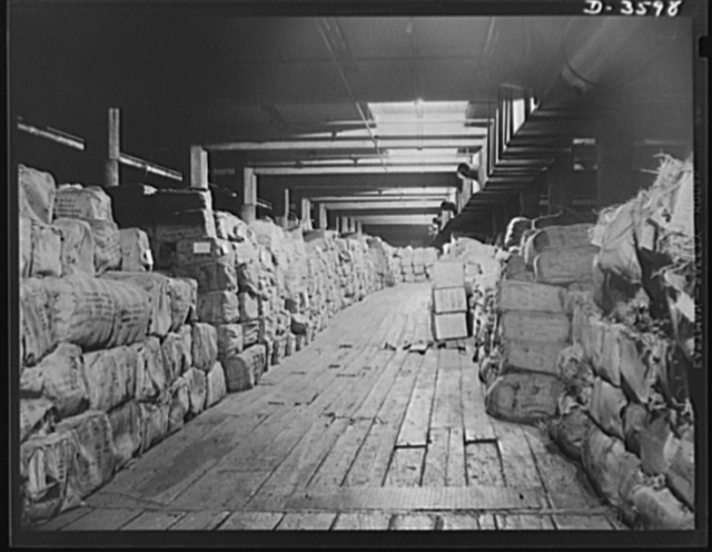 Rubber in storage. Number one U.S. stockpile. Crude rubber stored at points throughout the country is ample for all the needs of our armed forces. Boxes and bales weighing 250 pounds are stored in heating and thawing rooms to bring them to the proper temperature for processing