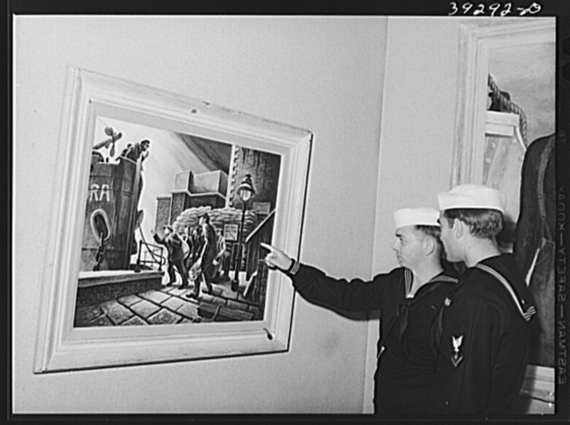 """Sailors looking at paintings by Thomas Benton at the fine arts building. This is a part of the """"Long Voyage Home"""" exhibit. San Diego, California"""