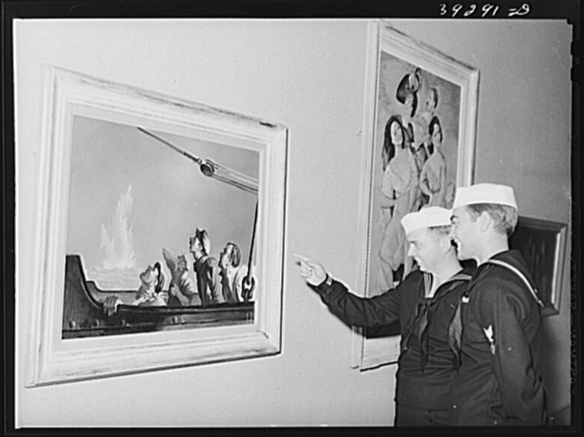 """Sailors looking at paintings of George Schrieber's at the fine arts building. This is a part of the """"Long Voyage Home"""" exhibit. San Diego, California"""