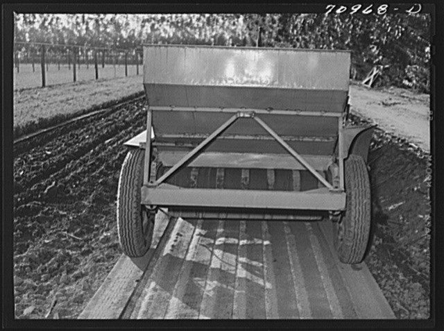 Salinas, California. Intercontinental Rubber Producers. Guayule planter. Seeds mixed with sawdust are planted by this machine which also distributes a thin stream of sand over the seeds. This is a nursery operation. Seedlings sprout in a few days, grow in the nursery about eight months before being transplanted into the field