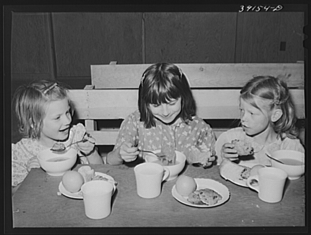 Schoolchildren eating lunch at the FSA (Farm Security Administration) farm workers' camp. Caldwell, Idaho