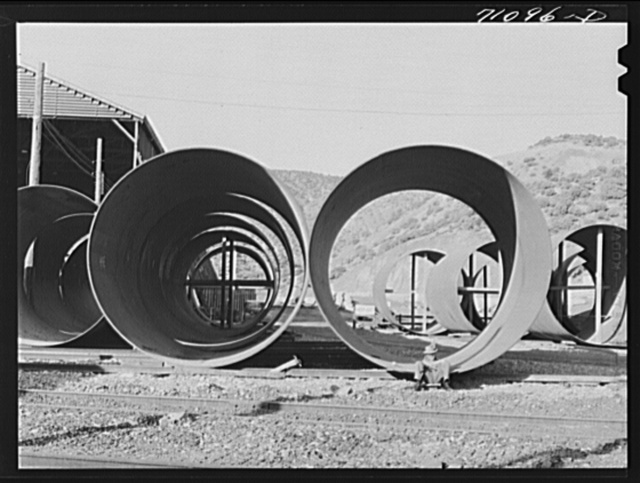 Segments of penstock pipe which will be used to conduct water from the reservoir formed by Shasta Dam to the hydroelectric turbines. Shasta County, California