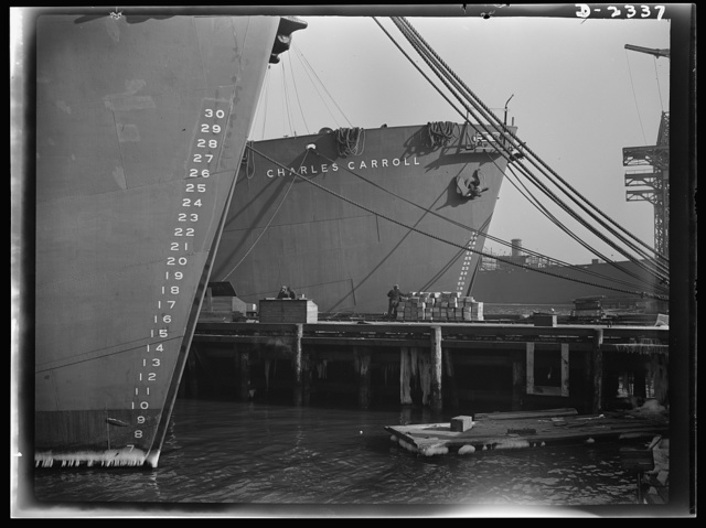 "Shipbuilding. ""Liberty"" ships. Here are two members of the Liberty Fleet lying at anchor in the basin of a large eastern shipyard, awaiting final fitting and rigging. Bethlehem-Fairfield Shipyards Inc., Baltimore, Maryland"