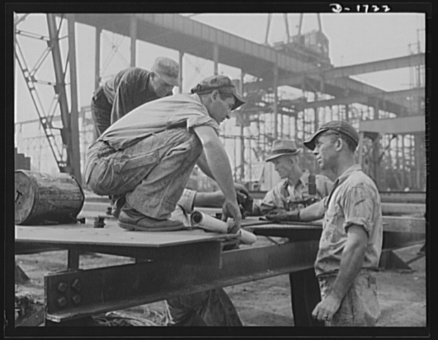 Shipbuilding (Newport News). Problems, major and minor, arise at every turn in the building of huge whips for Uncle Sam's growing Navy. In the foreground are structural section foremen working out one of their problems