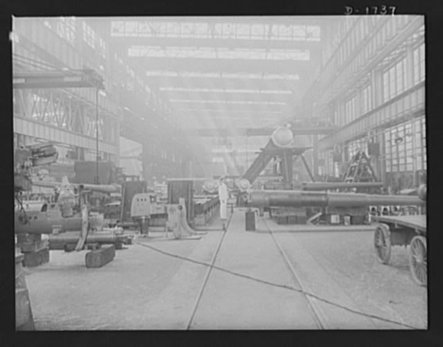 Shipbuilding (Norfolk Navy Yard). Huge naval guns are assembled in the gun shop for installation on the warcraft being built here for Uncle Sam's growing Navy
