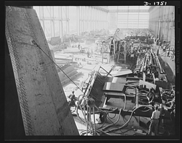 Shipbuilding (Norfolk Navy Yard). Hundreds of skilled workers are engaged in the welding shop. Welded jointures have many advantages over riveted fittings, and welders are sought in increasing quantities for work on Uncle Sam's growing battle fleet