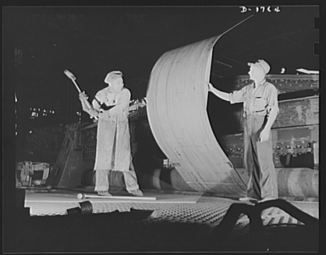 Shipbuilding (Norfolk Navy Yard). Manpower for defense is the specialty of the worker with the sledge hammer, about to pound a ship's plate. The sledge hammer is still an important tool in the production of Uncle Sam's new battle fleet