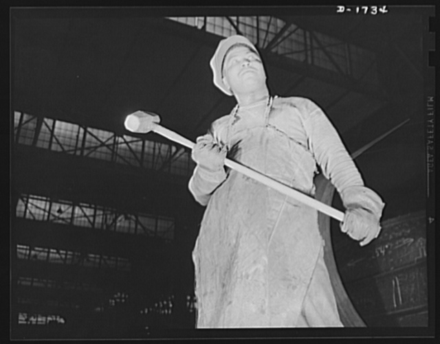 Shipbuilding (Norfolk Navy Yard). Power for defense is the specialty of this worker in the plate shaping shop. The sledgehammer is still an important tool in the building of ships for Uncle Sam's giant new fleet