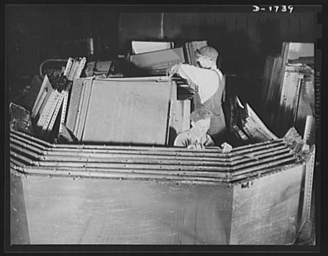 Shipbuilding (Norfolk Navy Yard). These workers are punching stainless steel for use in galleys and mess rooms in naval craft under construction at Norfolk