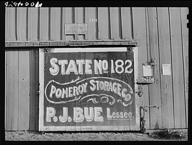 Sign on sack warehouse used for storing wheat. Garfield County, Washington