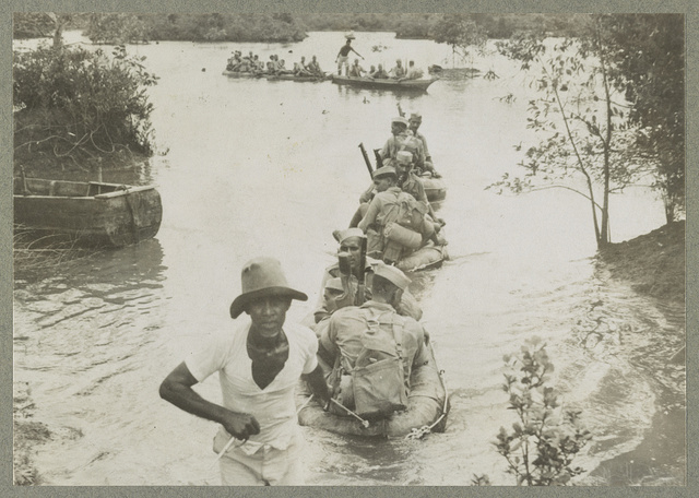 Singapore, Malaya Infantrymen of the Indian Army crossing a river in collapsible rubber boats.