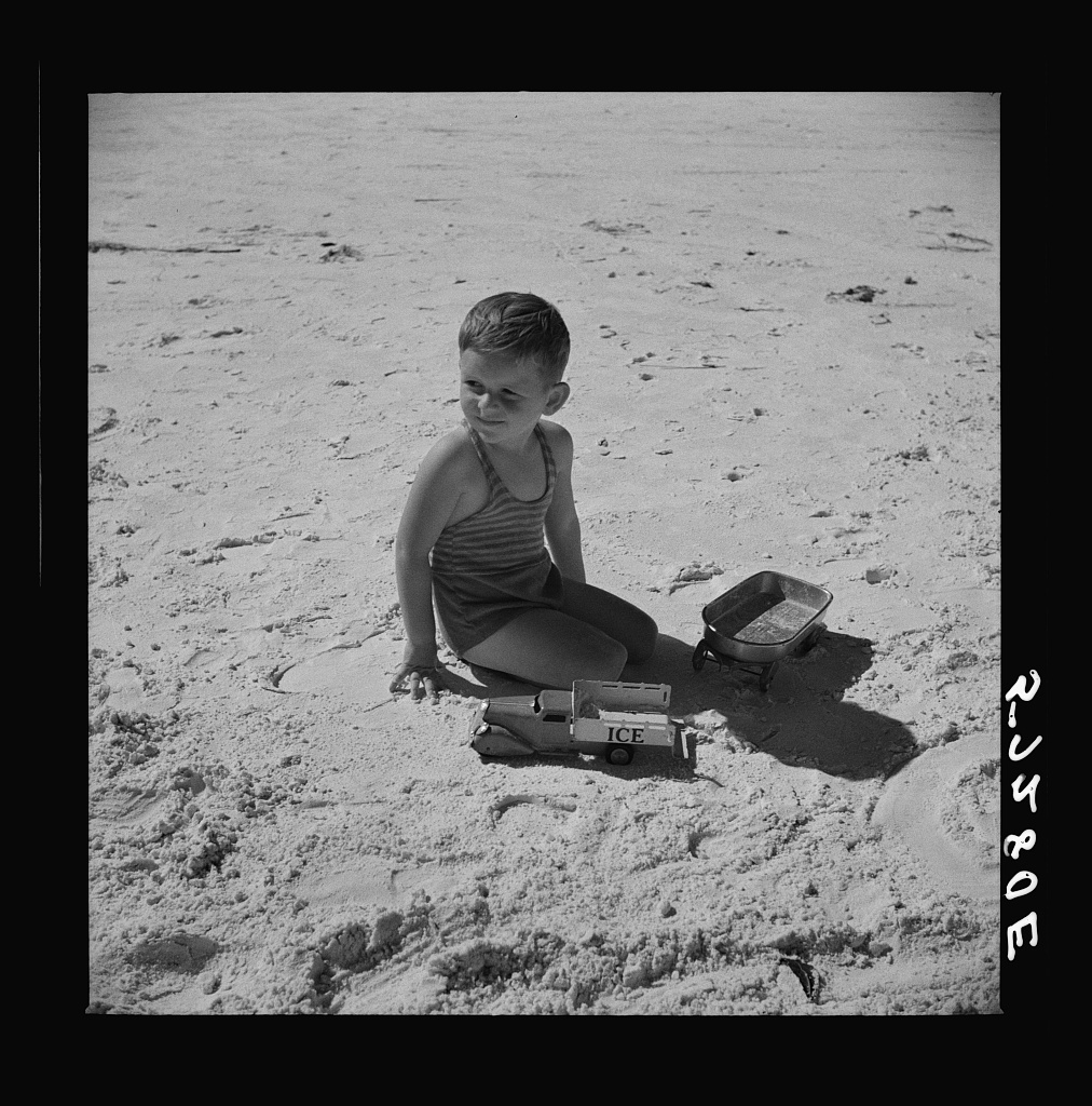 Son of parents who live at Sarasota trailer park, Sarasota, Florida, playing on the beach
