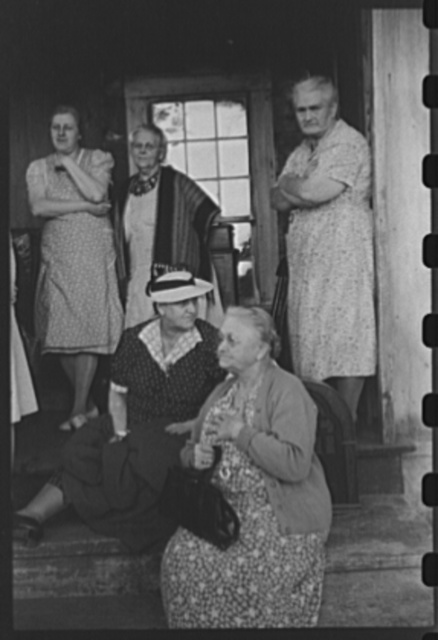 Spectators at an auction in East Albany, Vermont