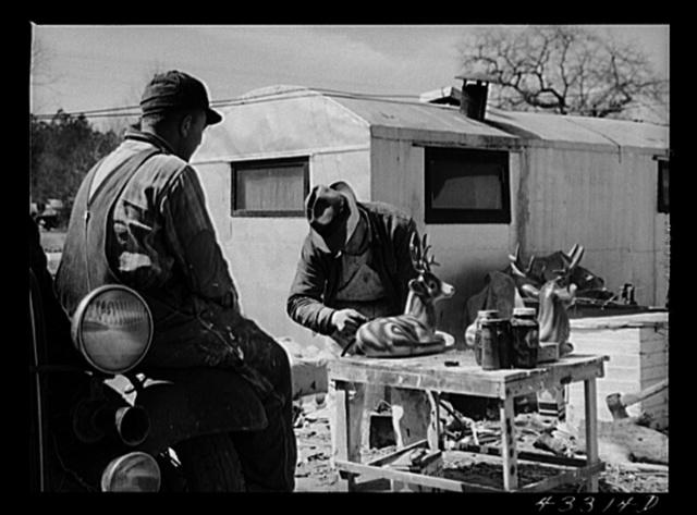 Spraying novelties to be sold along the roadside near Fort Bragg, North Carolina