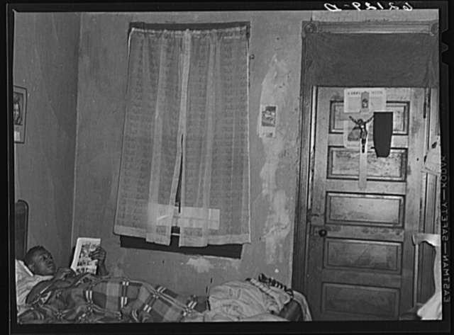 Steelworker who works on night shift in bed during day. Aliquippa, Pennsylvania