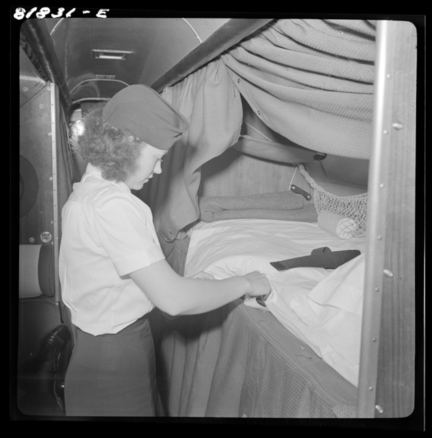 "Stewardess aboard American airliner, making up an ""upper"" bunk. San Francisco, California"
