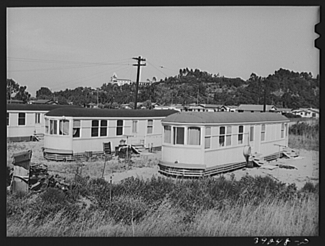Streetcars which have been converted into dwellings. These rent for twenty-five dollars per month. They are equipped with electricity, running water and bathrooms. San Diego, California