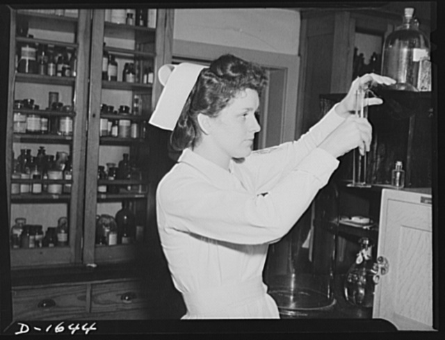 Student nurses spend many fascinating hours in the laboratory. Attractive young student, above, measures liquid for chemistry experiment