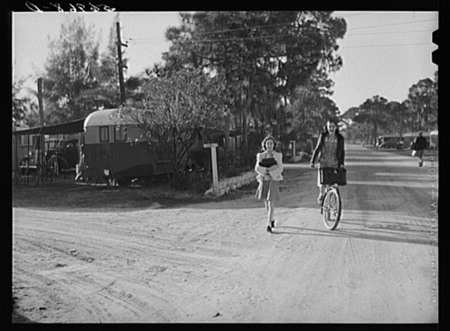 Students coming home from school in the afternoon. Sarasota trailer park, Sarasota, Florida