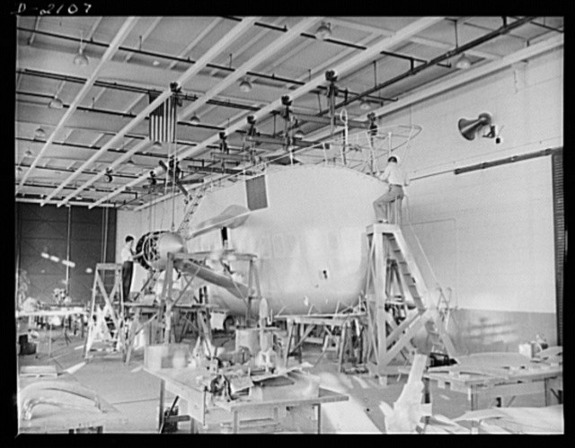 Subcontracting aircraft parts. Nearly ready to take its place in the battle for humanity, this control car for a naval non-rigid airship is receiving the finishing touches at the huge airship dock of an Ohio rubber company. Goodyear, Akron, Ohio