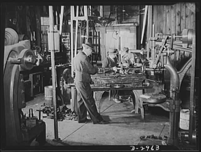 Subcontracting (Beery and Sons). Plant conversion means machine conversion. Here workers at the Harrisonburg, Virginia shop of Beery and Sons are converting a lathe to turn out parts for a war contractor. All the actual work of conversion and the new tools and jigs needed are made in the shop