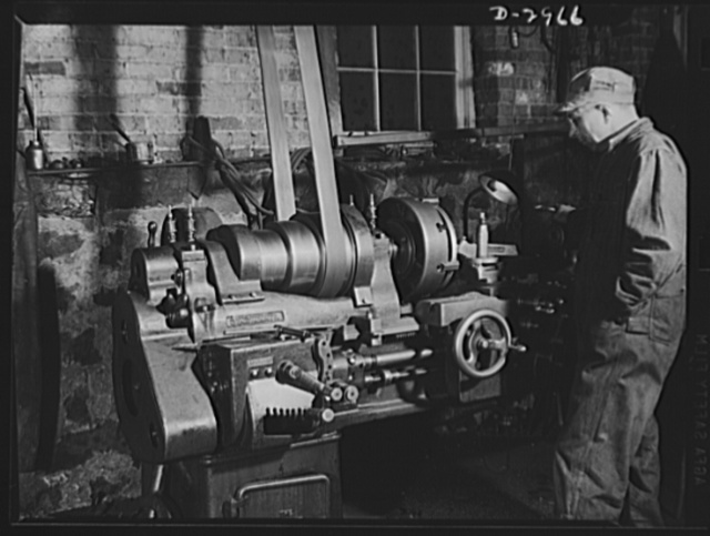 Subcontracting (Wilbarger and Sons). Workers at the shop of Wilbarger and Sons, Harrisonburg, Virginia, are doing away with the overhead belt system of operating their machines. Delays are too frequent and they will not brook delays in war production. The machines are being converted to direct gear transmission