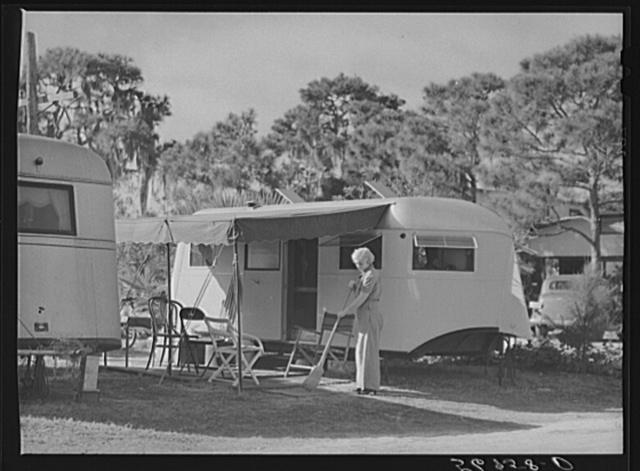 Sweeping up in front of trailer home. Sarasota trailer park, Sarasota, Florida